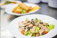 Delicious tuna salad served on white plate stock photos