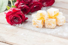 Delicious Turkish Delight with rose flower. Taste royalty free stock photography