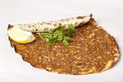 Delicious Turkish pizza lahmacun. On  background Royalty Free Stock Photo
