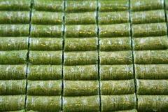 Delicious Turkish sweet, wrapped green pistachio nuts ( Sarma ) Royalty Free Stock Photos