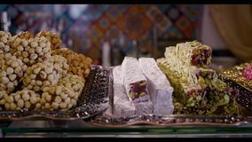 Delicious Turkish baklava on Bazaar. Delicious Turkish sweets baklava on middle east Bazaar stock footage