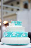 Delicious turquoise wedding cake Stock Images