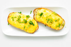 Delicious twice baked potatoes smothered with aged cheddar chees Royalty Free Stock Images