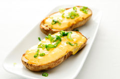 Delicious twice baked potatoes. Smothered with aged cheddar cheese Stock Photos