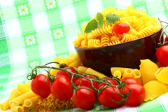 Delicious twig of tomatoes. With several pasta types Stock Photo
