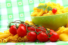 Delicious twig of tomatoes. With several pasta types Royalty Free Stock Photography