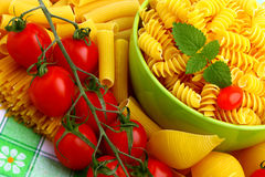 Delicious twig of tomatoes. With several pasta types Royalty Free Stock Photo