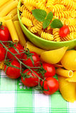 Delicious twig of tomatoes. With several pasta types Royalty Free Stock Images