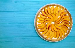 Tartlets with peach Royalty Free Stock Photo