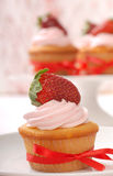 Delicious Vanilla cupcake with strawberry frosting Royalty Free Stock Photos