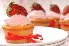 Delicious Vanilla cupcake with strawberry frosting Stock Photo