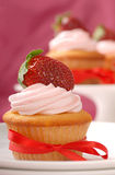 Delicious Vanilla cupcake with strawberry frosting Royalty Free Stock Photo