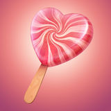 Delicious vanilla pink heart shaped lollipop Royalty Free Stock Photos