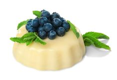 Delicious vanilla pudding with berries. On white background Stock Images