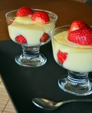 Delicious vanilla puding in glass with fresh strawberry Royalty Free Stock Photography