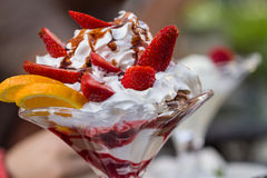 Delicious vanilla sundae with strawberry Stock Photography