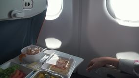 Delicious and varied dinner on board aircraft stock footage video stock video