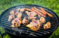 Delicious variety of meat on barbecue grill with char coal. stock images