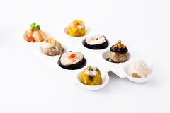Delicious variety steamed Dim sum. On plate stock photos