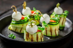 Delicious various finger food with fresh ingredients for party. On black table Royalty Free Stock Images