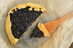 Delicious vegan galette with wild blueberry cut with wooden spat Royalty Free Stock Image