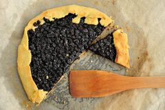 Delicious vegan galette with wild blueberry cut with wooden spat Royalty Free Stock Images