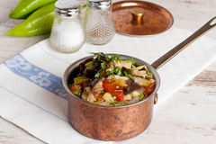 Delicious vegetable stew in a pan. Horizontal top view, close-up Stock Photography