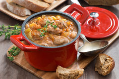 Delicious vegetable stew with sausages in a pan Royalty Free Stock Images