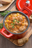 Delicious vegetable stew with sausages in a pan, top view Stock Images