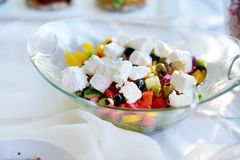 Delicious vegetables and goat cheese salad served on a party or wedding reception Stock Images