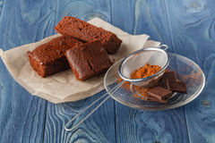Delicious vegetarian brownie slice for gourmet on wooden table Stock Photos