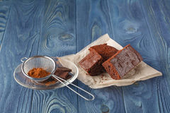 Delicious vegetarian brownie slice for gourmet on wooden table Royalty Free Stock Photo