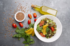 Delicious vegetarian lentil salad with lemon, mint and cherry tomato Stock Photo