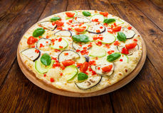Delicious vegetarian pizza with aubergines and zucchini Stock Photos