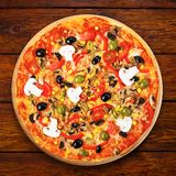 Delicious vegetarian pizza with tomatoes, mushrooms and olives Royalty Free Stock Photography