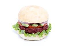Delicious veggie burger. With avocado, onion and tomato Royalty Free Stock Photo