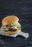 Delicious veggie Burger - cabbage, tomato, cucumber, lettuce, and a homemade bun for burgers Royalty Free Stock Image