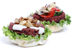 Delicious veggie burger. Delicious topless veggie burgers with fixings Royalty Free Stock Photography