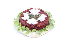 Delicious veggie burger. Delicious topless veggie burger with cheese and capers Royalty Free Stock Image