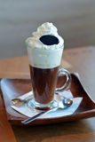 Delicious Viennese coffee in glass cup with whipped cream Stock Photos