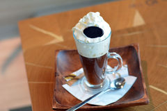 Delicious Viennese coffee in glass cup with whipped cream Royalty Free Stock Photo