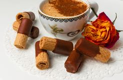 delicious wafers with chocolate , coffee with cinnamon, rose Royalty Free Stock Photography