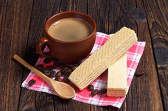 Delicious wafers and coffee Royalty Free Stock Photography