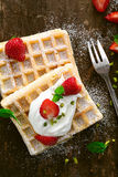Delicious waffle topped with cream Royalty Free Stock Image