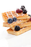 Delicious waffles with berries. Stock Photo