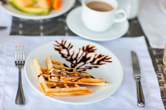 Delicious waffles with coffee Stock Image