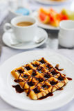 Delicious waffles with coffee Royalty Free Stock Image
