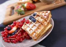 Delicious waffles and fresh berries. Fresh berries and sweet waffles for breakfast Stock Photos