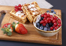 Delicious waffles and fresh berries. Fresh berries and sweet waffles for breakfast Stock Photography