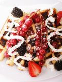 Delicious waffles and fresh berries Stock Images